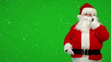 Santa claus calling by mobile cell phone