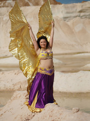 Dancer with gold wings