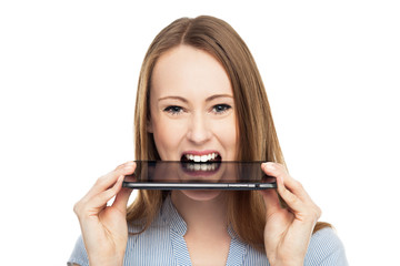 Woman with digital tablet in mouth