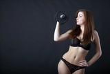 sexy woman in lingerie with dumbbell