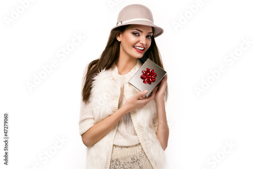 christmas picture of elegant woman holding a present