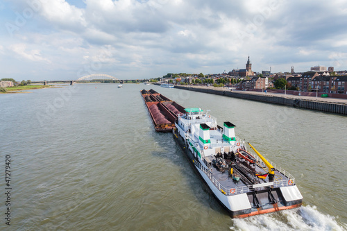 Cargo riverboat passing the Dutch city Nijmegen