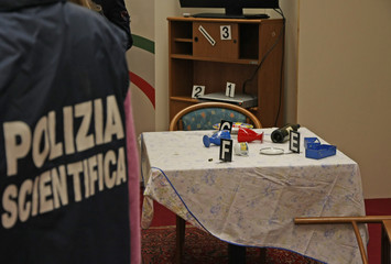 Italian scientific police with the jacket inside a crime scene