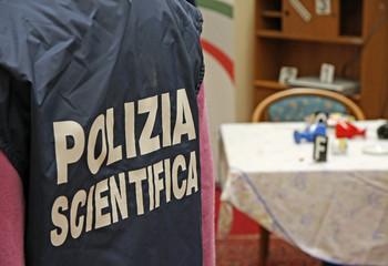 Italian scientific police  inside a crime scene