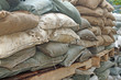 Brown and green sandbags to guard against attacks
