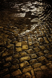 wet cobbled road