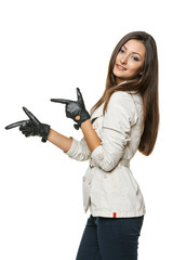 Woman in gloves pointing with both hands to the side