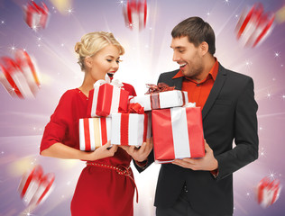 man and woman with gift boxes