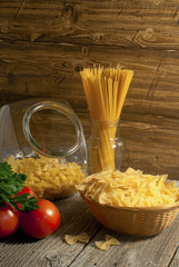 Composition of pasta, tomatoes and herbs.