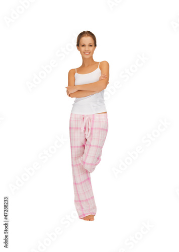 happy and smiling woman in cotton pajamas