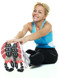 Beautiful atletic woman exercising on the floor