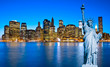 Manhattan Skyline and The Statue of Liberty at Night, New York C