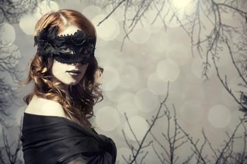 Beautiful women in carnival mask.