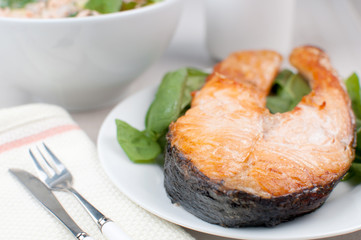 Steak of salmon with spinach and salad