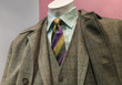 Grey & yellow checkered coat and suit with striped tie
