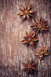 Star anise on rustic wooden surface