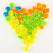Colorful quilling laid out in form of heart isolated on white
