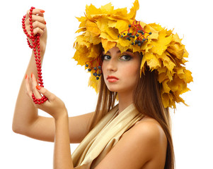 beautiful young woman with yellow autumn wreath and beads,