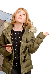 Dubious blonde woman watching the weather