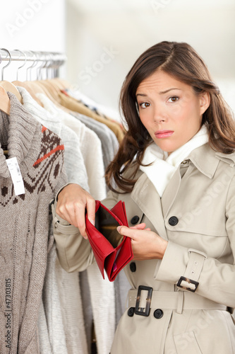 Woman shopper holding empty wallet or purse