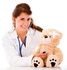 Doctor fixing a sick teddy bear