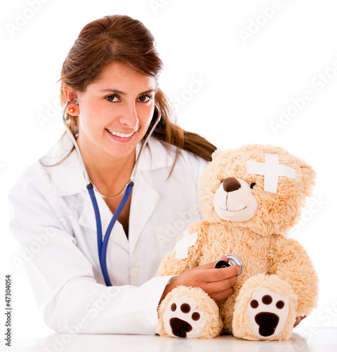 Doctor fixing a sick teddy bear