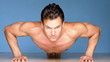 Male athlete performs modified angled pushups