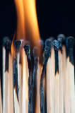 Fire from matches, black background, vertical shot