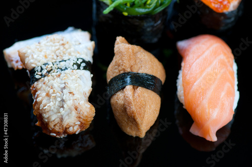 Horizontal shot of a sushi set on a black plate
