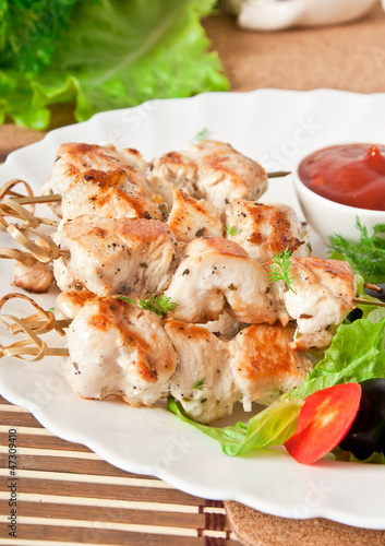 skewers of chicken with salad