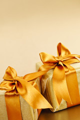 Two golden wrapped gift boxes