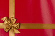 Red gift background with gold ribbon
