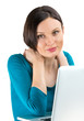 Portrait of young woman dreaming in front of laptop