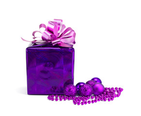 Gift and beads on a white background