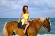 Nice young woman riding a horse