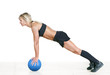strong woman doing push-up on a ball