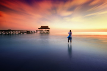 Man photographed sunset near the pier