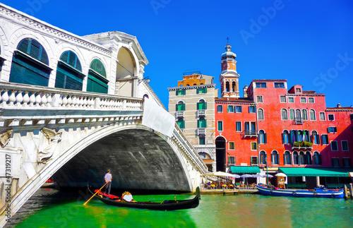 Famous Rialto bridge with Gondola in Venice, Italy