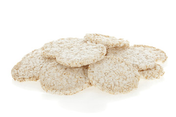 Diet rice cakes pile isolated on white background.