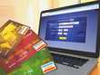 E-commerce. Credit cards on laptop