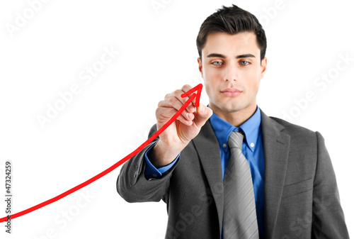 Businessman drawing a growing business graph isolated