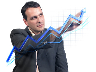 Businessman drawing virtual success graph