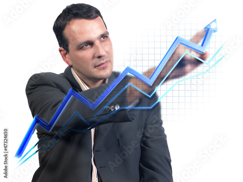Businessman drawing virtual success graph