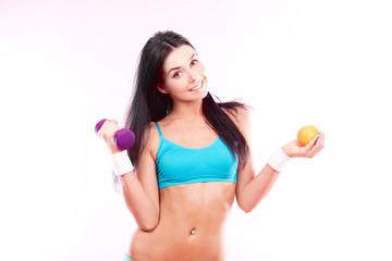 woman with dumbbell and orange