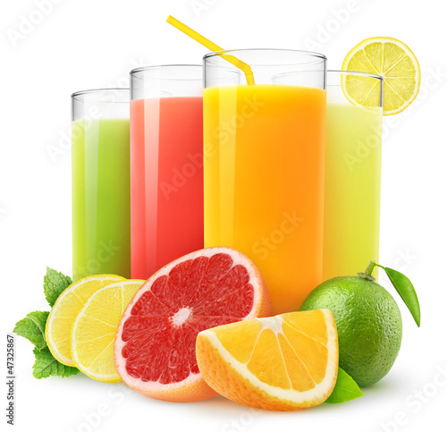 Leinwandbild Motiv Isolated drinks. Glasses of fresh citrus juices (orange, grapefruit, lemon, lime) and cut fruits isolated on white background