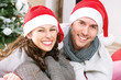 Christmas Couple wearing Santa's Hat