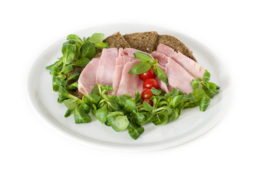 bread, ham, tomato served on a white  plate