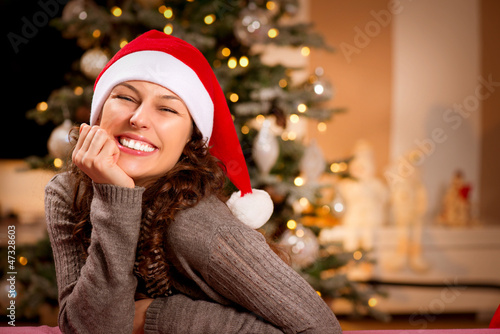 Christmas Woman in Santa Hat. Happy Smiling Girl