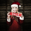 Christmas Woman With Smile And Xmas Sale Sign