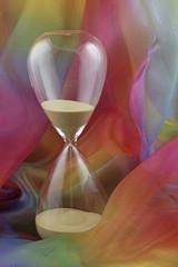 Hour glass on chiffon background